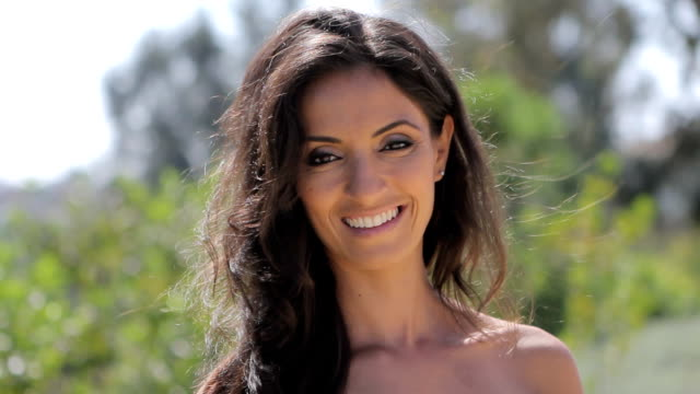 Closeup of beautiful woman smiling at camera.