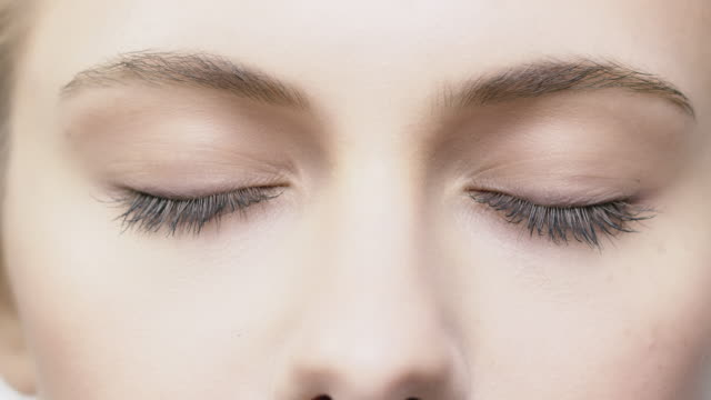 close-up of beautiful woman with closed eyes - beauty treatment stock videos & royalty-free footage