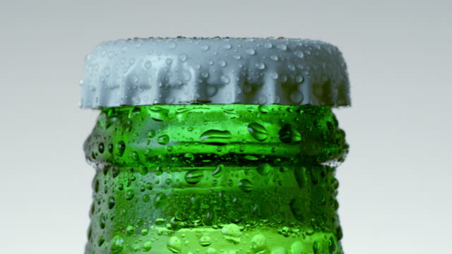 close-up of beer bottle cap - oggetto creato dall'uomo video stock e b–roll
