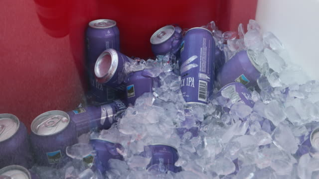 Closeup of beer cans on ice Alcohol products including beer and wine are sold for the first time at Indiana University's Memorial Stadium before an...