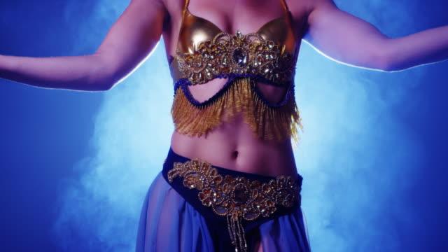 closeup of belly dancer's torso - torso stock videos & royalty-free footage