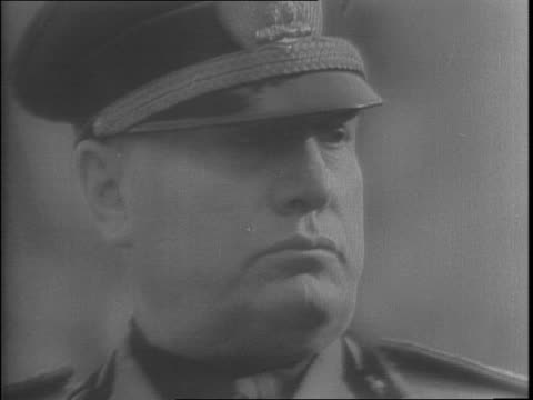 closeup of benito mussolini / king victor emmanuel iii walking up to throne and saluting as advisors follow / king victor sitting surrounded by... - benito mussolini stock videos & royalty-free footage