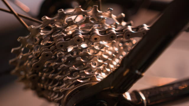Close-up of bicycle gear and chain in motion