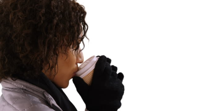 closeup of black woman drinking cup. portrait of pretty black woman holding paper cup on white background. - neckwear stock videos and b-roll footage