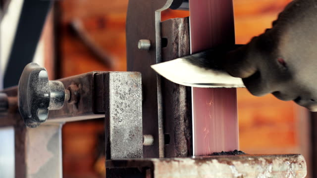 close-up of blacksmith sharpening a knife - knife weapon stock videos & royalty-free footage