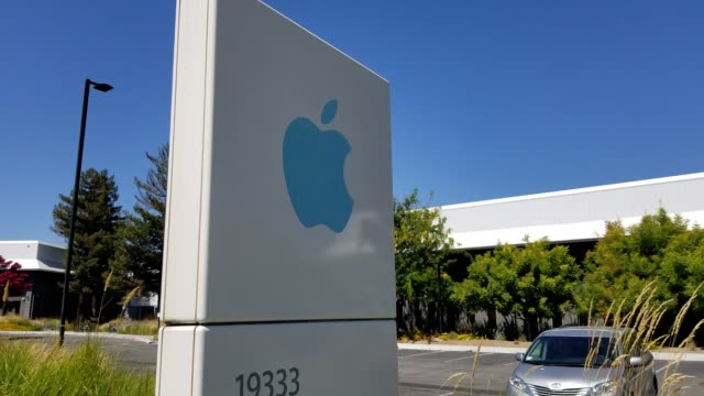 closeup of blue apple computers logo on sign near the company's headquarters in the silicon valley cupertino california august 26 2018 - silicon valley stock videos & royalty-free footage
