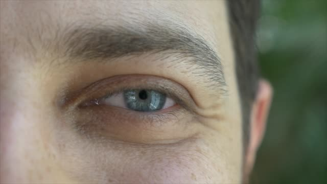 close-up of blue eyes of a man - blue eyes stock videos & royalty-free footage