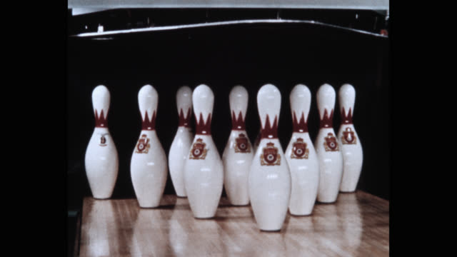 close-up of bowling ball hitting set of pins at bowling alley - bowling alley stock videos & royalty-free footage