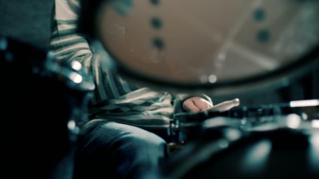Close-up of boy drumming