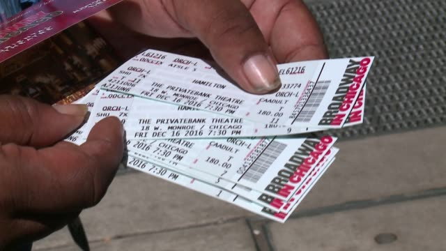"""close-up of broadway musical """"hamilton"""" tickets outside the private bank theatre in chicago on june 21, 2016. - hamilton new york state stock videos & royalty-free footage"""