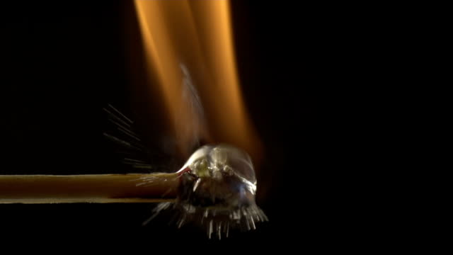 Close-up of burning Match getting hit by a water drop