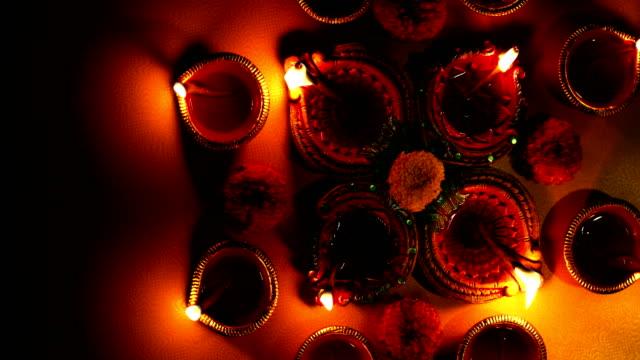 close-up of burning oil lamps, delhi, india - ヒンズー教点の映像素材/bロール