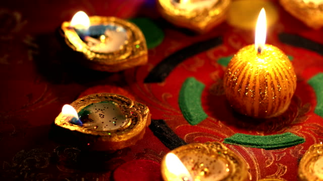 Close-up of burning oil lamps with candles, Delhi, India