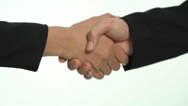 close-up of business partners shaking hands - formal stock videos & royalty-free footage