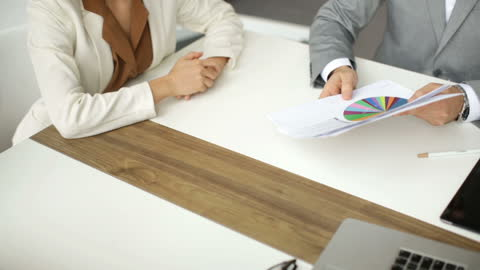 close-up of business person hand working on paperwork - obscured face stock videos & royalty-free footage