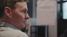 Close-up of businessman looking away in seminar