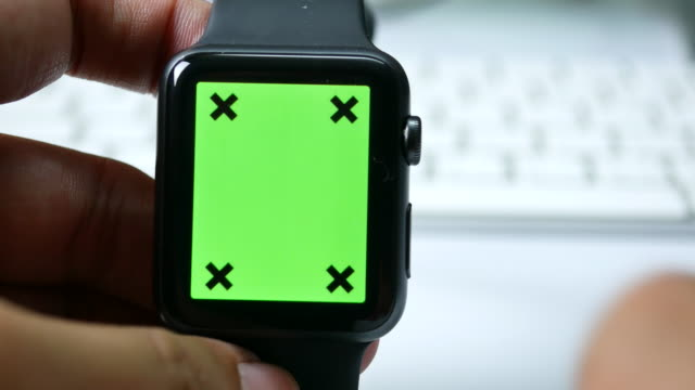 Close-up of Businessman Setting on smart watch, Green screen