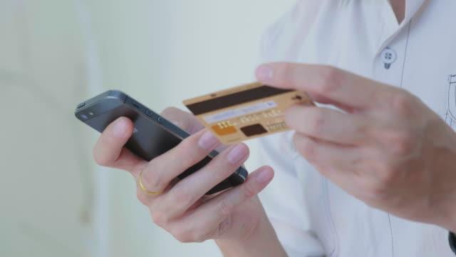 Close-up of Businessman shopping online on Mobile phone,Tilt down