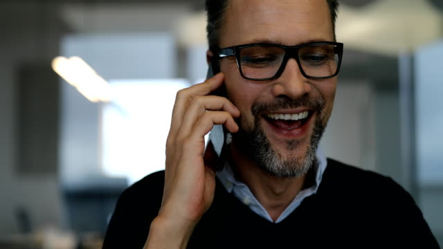 close-up of businessman talking on smart phone - usare il telefono video stock e b–roll