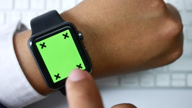 Close-up of Businessman using smart watch, Green screen