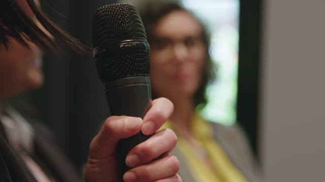 close-up of businesswoman holding microphone - microphone stock videos & royalty-free footage