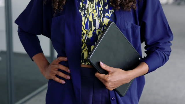 close-up of businesswoman with a digital tablet - hand on hip stock videos & royalty-free footage