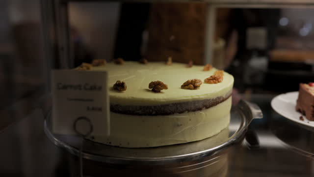 close-up of carrot cake with label in cabinet - display cabinet stock videos & royalty-free footage