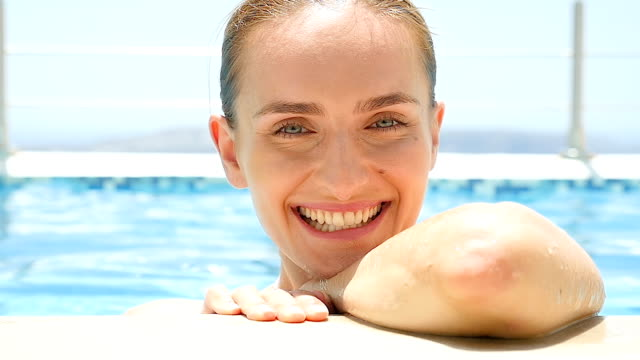Close-up of charming woman in pool