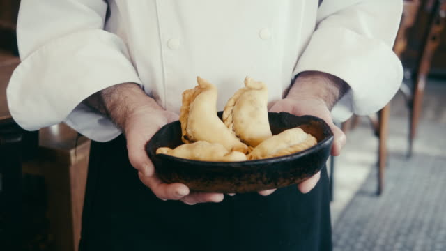 close-up of chef holding empanadas in argentinian restaurant - argentina stock videos & royalty-free footage