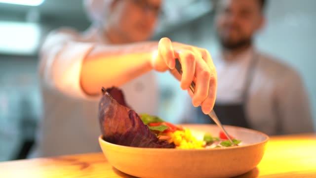 close-up of chef preparing a dish - posizionare video stock e b–roll