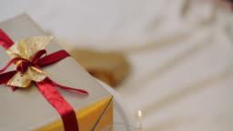 Closeup Of Christmas Gift Box Tied With Ribbon
