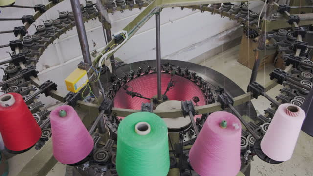 close-up of circular knitting machine in knitting factory - ball of wool stock videos & royalty-free footage