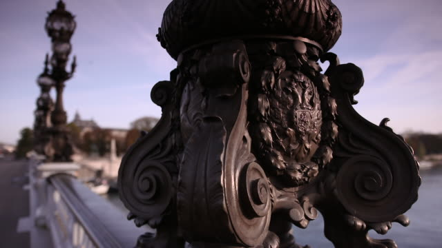 close-up of coat of arms on lamp posts on pont alexander iii, paris, france - ornate stock videos & royalty-free footage
