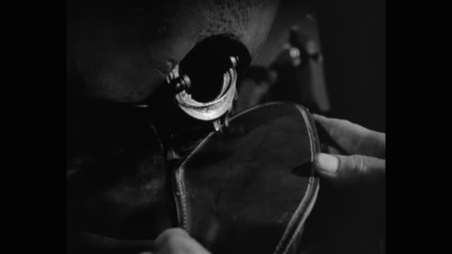 close-up of cobbler stitching sole of shoe in workshop - animal skin stock videos & royalty-free footage