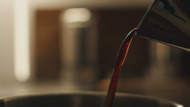 close-up of coffee falling in container at factory - coffee drink stock videos & royalty-free footage