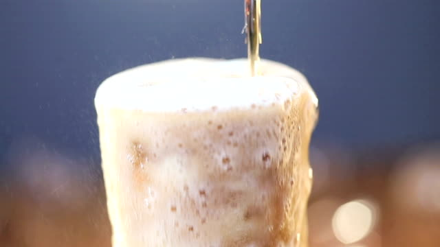 close-up of cold drink pouring into a glass - overflowing stock videos & royalty-free footage