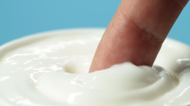 close-up of cosmetics cream on blue background - skin care stock videos & royalty-free footage