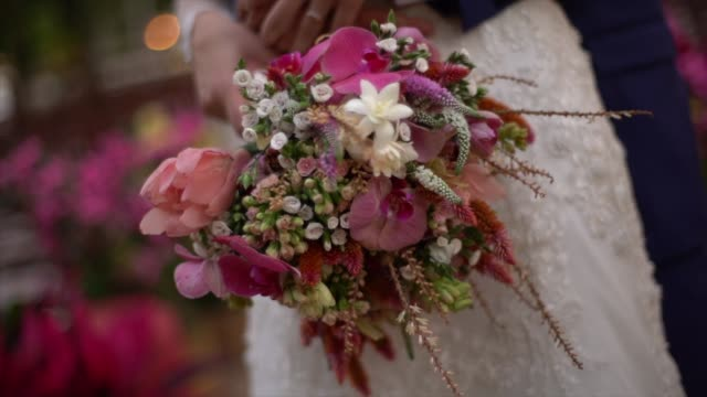 close-up of couple holding a flower bouquet - bunch of flowers stock videos & royalty-free footage