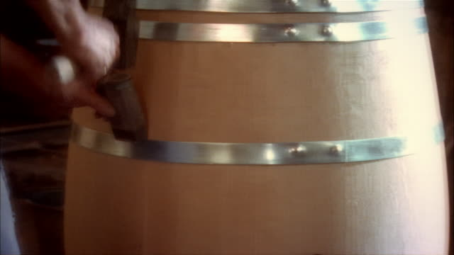 close-up of craftsman building wine cask - wine cask stock videos and b-roll footage