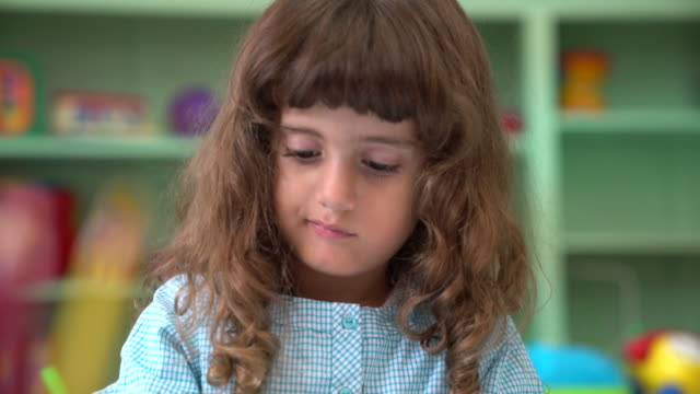 close-up of cute preschool girl in classroom - colored pencil stock videos and b-roll footage