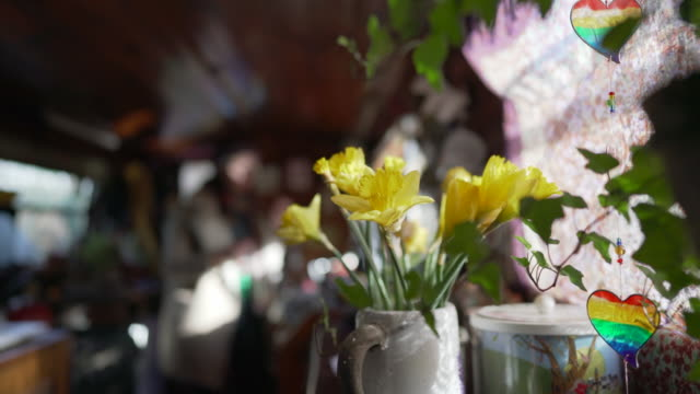 a close-up of daffodils in a vase inside a narrow boat - barge stock videos & royalty-free footage
