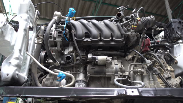 closeup of disassembled complicated car engine under repair - chain object stock videos & royalty-free footage