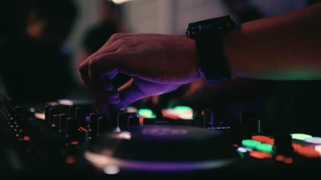 close-up of dj hands mixes the track on stage in night club at party - techno music stock videos & royalty-free footage