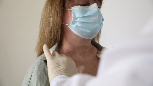 close-up of doctor checking the lymph glands in the neck of a woman. - lymph node stock videos & royalty-free footage