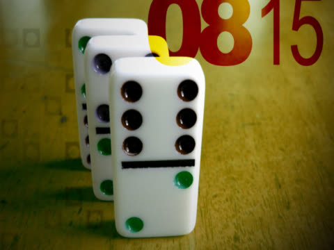 Close-up of dominoes falling