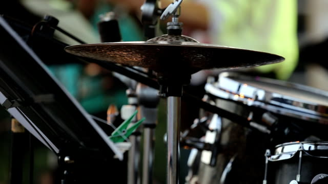 Close-up of drummer hitting hi-hat cymbals