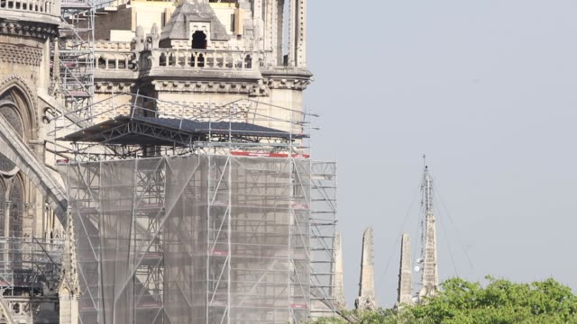closeup of east facade of cathedral with scaffolding / a fire broke out on monday afternoon and quickly spread across the building causing the famous... - spire stock videos and b-roll footage