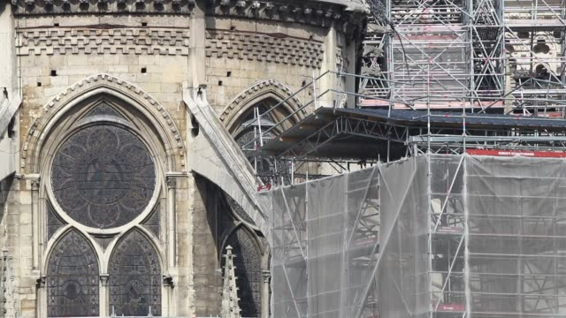 close-up of east facade of cathedral with scaffolding / a fire broke out on monday afternoon and quickly spread across the building, causing the... - spire stock videos & royalty-free footage