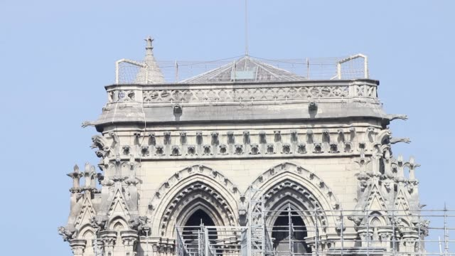 close-up of east facade of cathedral with scaffolding, tower / a fire broke out on monday afternoon and quickly spread across the building, causing... - spire stock videos & royalty-free footage