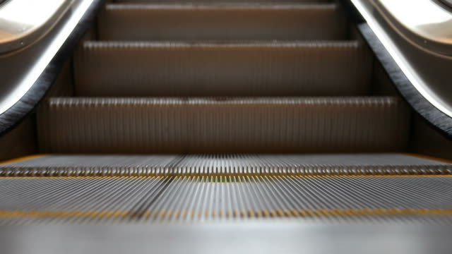 closeup of empty escalator - escalator stock videos & royalty-free footage